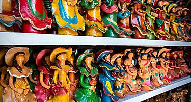 Wooden carved and painted traditional dolls in the shops in Punta Cana, Dominican Republic