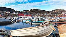 A moored boat at a marina in Qaqortoq, Greenland