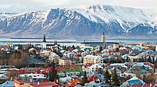 Aerial view of Reykjavik, Iceland with mountains in the background.
