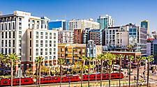 Gaslamp Quarter cityscape with red train in San Diego, California