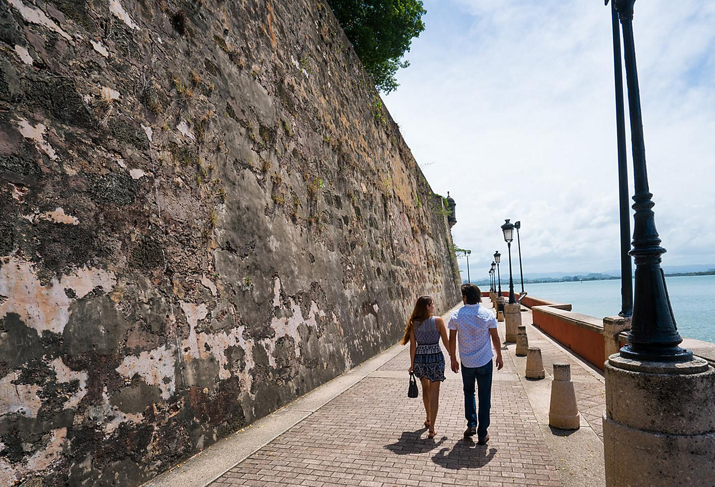 Couple Strolling Fort San Cristobal