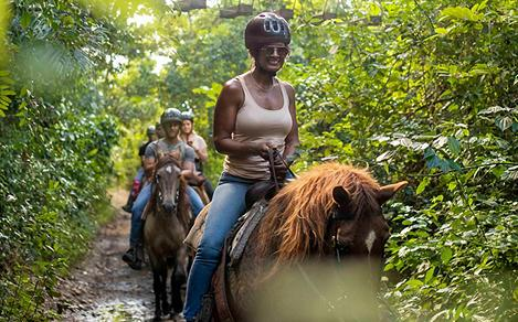 Woman HorseBackRiding in San Juan