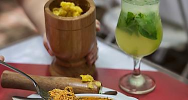 Traditional Puerto Rican dish with a glass of mojito