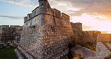 Castle of San Pedro de la Roca and Fort in Santiago, Cuba during sunset