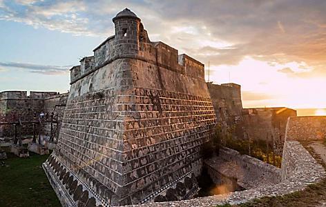 Castle of San Pedro de la Roca and Fort in Santiago, Cuba during sunset