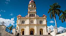 A church with palm trees on a sunny day in Santiago, Cuba