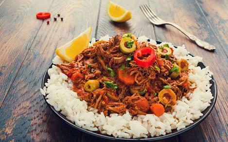 Ropa Vieja, which is white rice with shredded beef, is a local cuisine in Santiago, Cuba