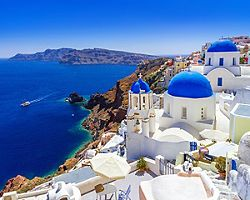 Classic white and blue houses of Oia in Santorini, Greece