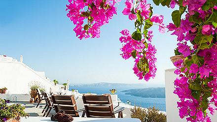 View of the sea from a beautiful terrace with flowers in Santorini, Greece
