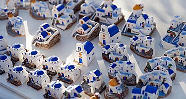 Small white and blue house souvenirs in Santorini, Greece