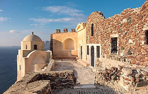 Early morning in Byzantine Castle Ruins in Oia village, Santorini, Greece