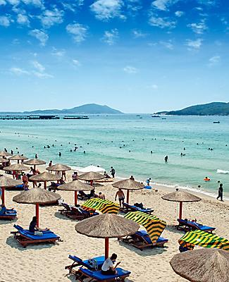 People enjoying a beach in Sanya, China