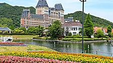 Colorful flower garden with European stlye building in the background at Huis Ten Bosch in Sasebo, Japan