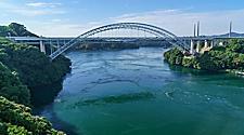 View of Saikai bridge with whirlpools on the water