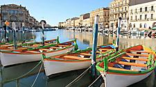 Colorful traditional boats at a harbor in Sete, France