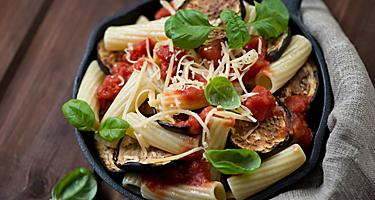 A bowl of pasta alla norma with eggplant and tomato