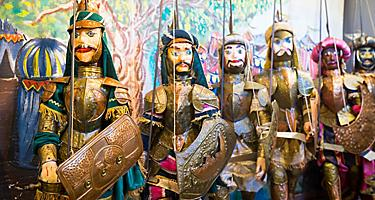 Various sicilian puppets at a market