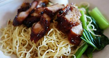 Wantan Mee, popular street food noodles with bbq pork, in Singapore