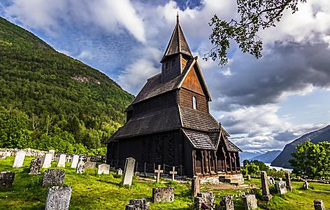 The Urnes Stave Church with its surrounding cemetery in Norway