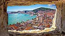 Beautiful high view of Split bay area through a stone window in Split, Croatia