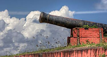 Canon perched atop the red walls of Fort Frederik, St. Croix, U.S. Virgin Islands