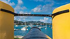 Canon overlooking harbor at yellow brick Fort Christiansted, St. Croix, U.S. Virgin Islands