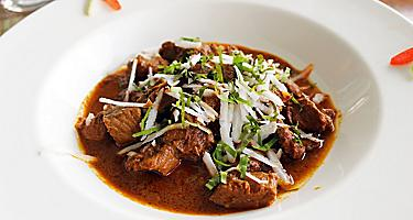 Mid close up shot of a bowl of Goat Curry
