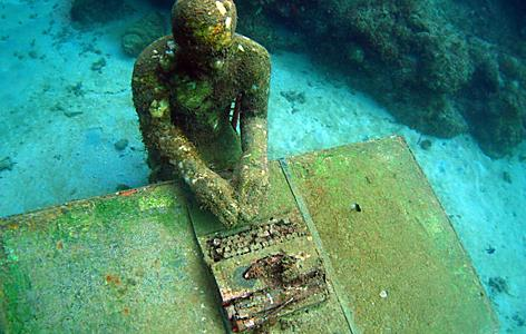 Underwater sculpture of man with typewriter in St. George's, Grenada