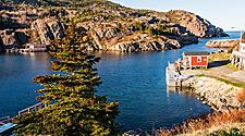 A scenic coastal landscape with fishing houses in St. John's, Newfoundland