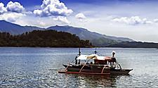 Boat on a peaceful blue sky scenery in Subic Bay, Philippines