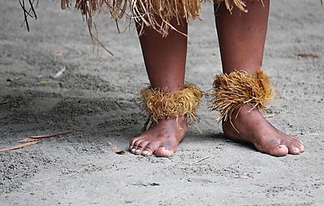 A Fijian man dancing