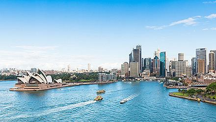 View of the Sydney Opera House, Circular Quay with the Skyline in the distance in Australia
