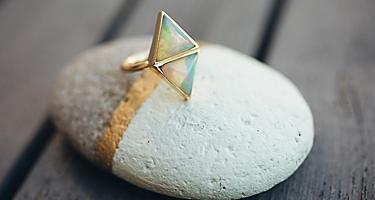 An opal ring displayed on a stone