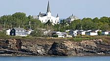 Buildings on a coastal cliff in Sydney, Nova Scotia