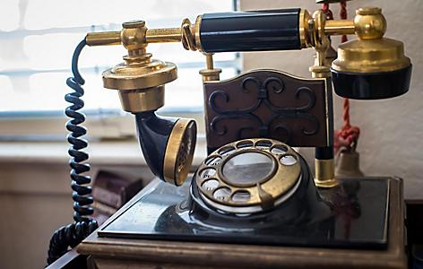 An antique black and gold telephone