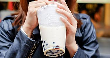 A woman drinking pearl milk tea