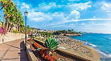 A beachfront walking path at El Duque beach in Tenerife, Canary Islands