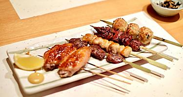 Chicken yakitori on a white plate
