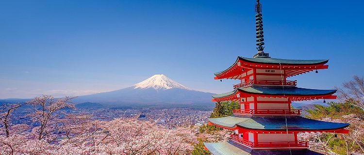 The upper levels of Chureito Red Pagoda with Mount Fuji in the distance