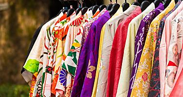 An assortment of kimonos on a rack in Japan