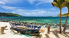 Small boat washed up on shore of the beach in Tortola, British Virgin Island