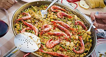 A Valencian paella being served