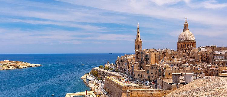 Coastal view of the sea wall and buildings in Valletta, Malta