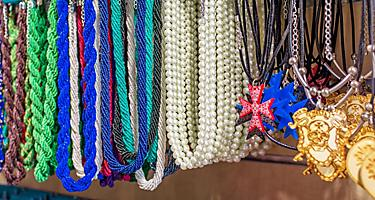 An assortment of souvenir necklaces