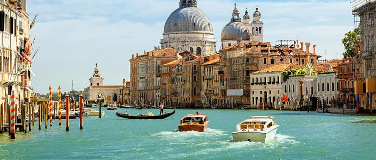 Boats travelling down the Grand Canal in Venice, Italy