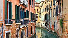 A narrow canal in Venice, Italy