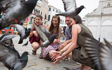 Italy Venice Piazza San Marco Family Enjoying the Pigeons