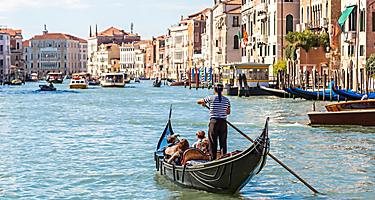 A group riding in a gondola in Venice, Italy