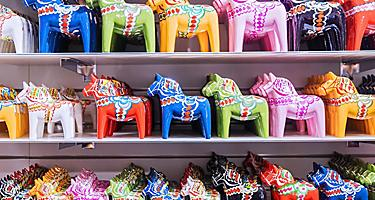 A variety of colorful miniature horse souvenirs