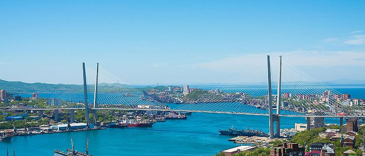 Day time cityscape of Vladivostok, Russia, with Zolotoy Golden Bridge in the background